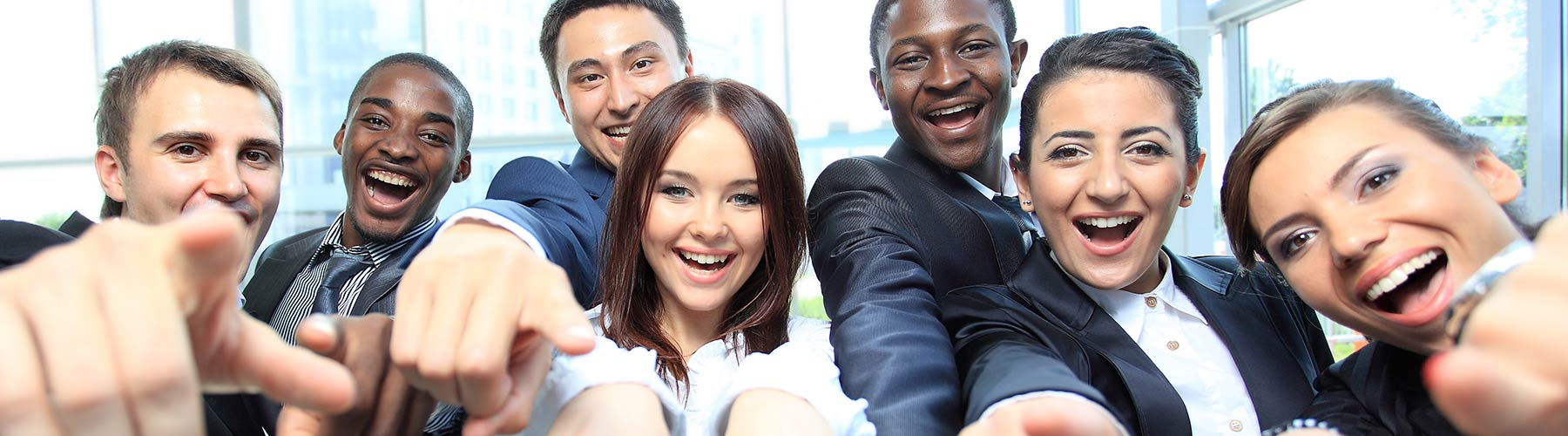 group of business people pointing at the camera